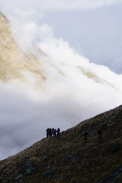 Leaving the Tasch Hut and hiking in the morning dew and clouds