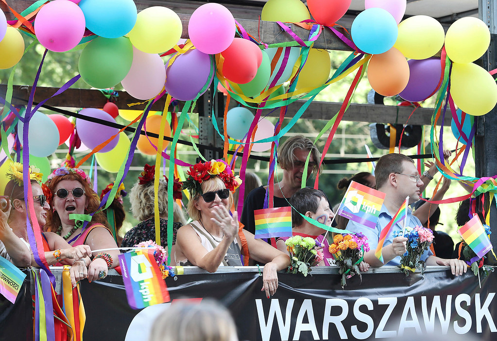 . People take part in the Gay Pride parade in Warsaw, Poland, Saturday, June 9, 2018. The pride celebrations come as LGBT activists say a conservative turn in Poland is only motivating them to fight harder for their rights, even though their hopes of seeing same-sex marriage legalized has no chance now in the country. (AP Photo/Czarek Sokolowski)