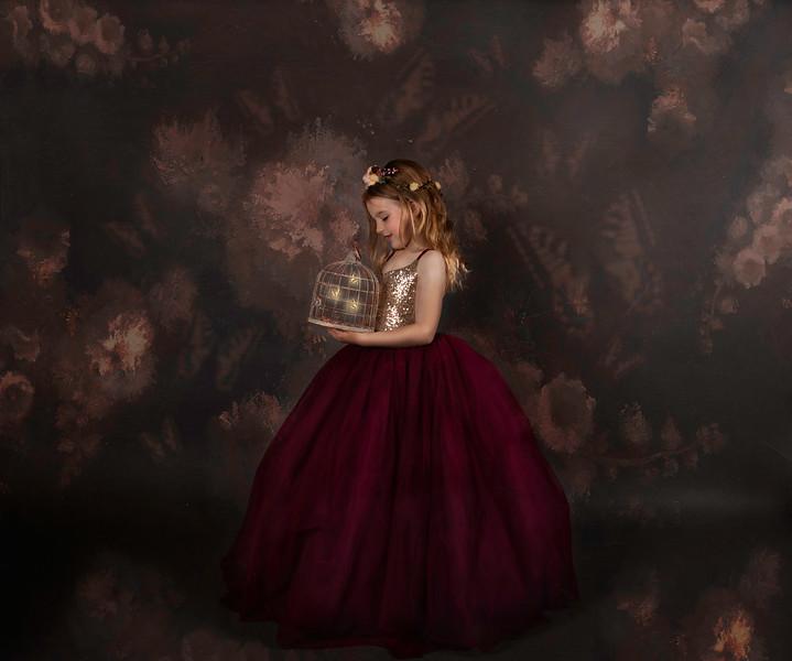 madelyn lloks at butteflys in maroon dress.jpg
