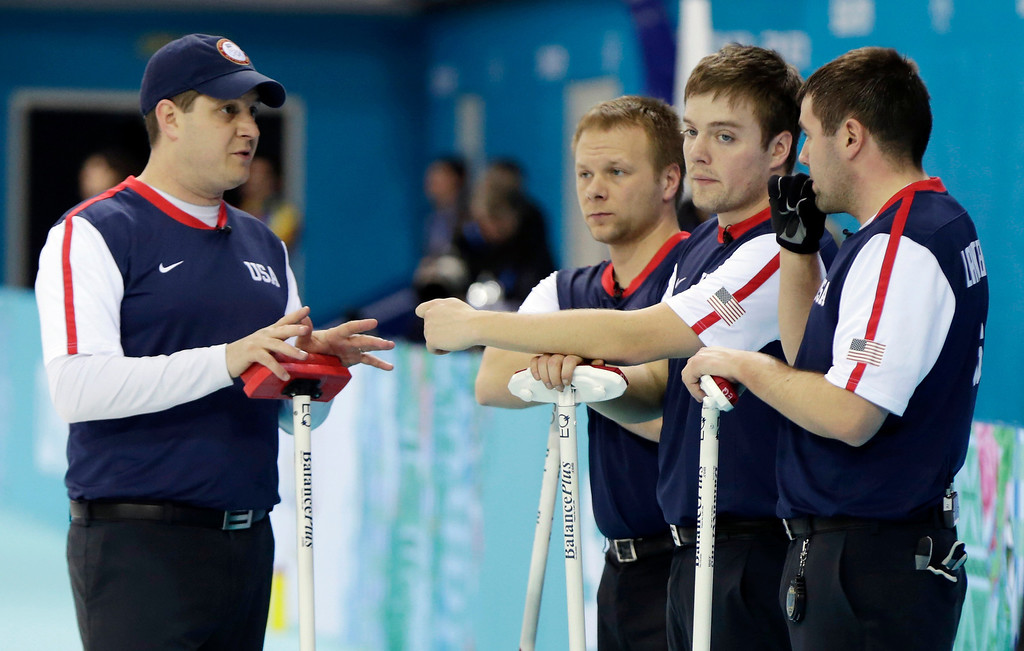 . Team USA\'s skip John Shuster, far left, gives some advice to his teammates Jeff Isaacson, Jared Zezel and John Landsteiner after faking behind early to Norway during men\'s curling competition at the 2014 Winter Olympics, Monday, Feb. 10, 2014, in Sochi, Russia. (AP Photo/Robert F. Bukaty)