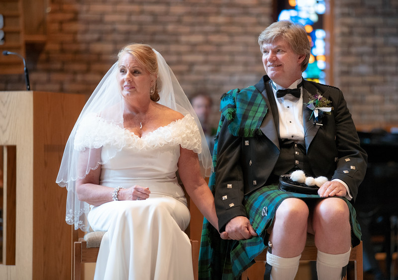 Bride and Groom Sitting at the Altar.jpg