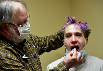 Photos: Nederland Doctor Helping Sick and Testing for COVID-19