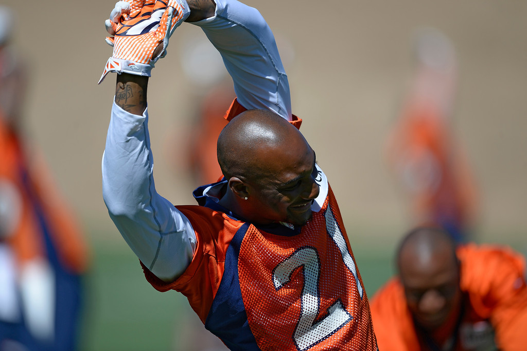. Denver Broncos cornerback Aqib Talib (21) stretches during OTAs June 2, 2014 at Dove Valley. (Photo by John Leyba/The Denver Post)