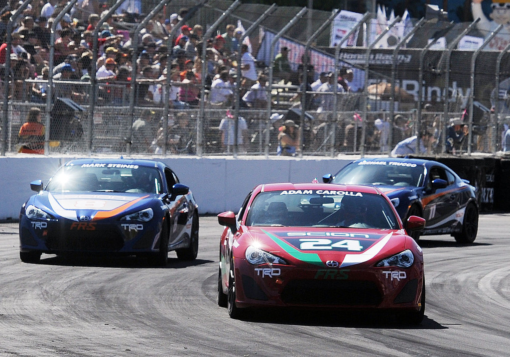 . (Will Lester/Staff Photographer)  Adam Carolla (center) leads Mark Steines (left) and Michael Trucco (rear) during the Pro and Celebrity qualifying session April 19, 2013 at the 39th annual Toyota Grand Prix of Long Beach.