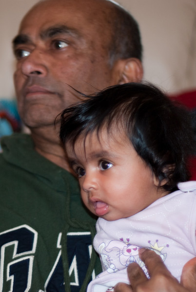 Baby Shyla watches cricket with her Dada