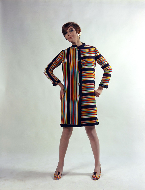 . Of black and white, yellow and red vertical and horizontal striped wool, with an original row of buttons closing half of the front line and being repeated on half of the back line. Created by the Faraoni house of Rome and Naples, presented at Florence fashions Italian coatdress, Jan. 18, 1967. (AP Photo/Mario Torrisi)