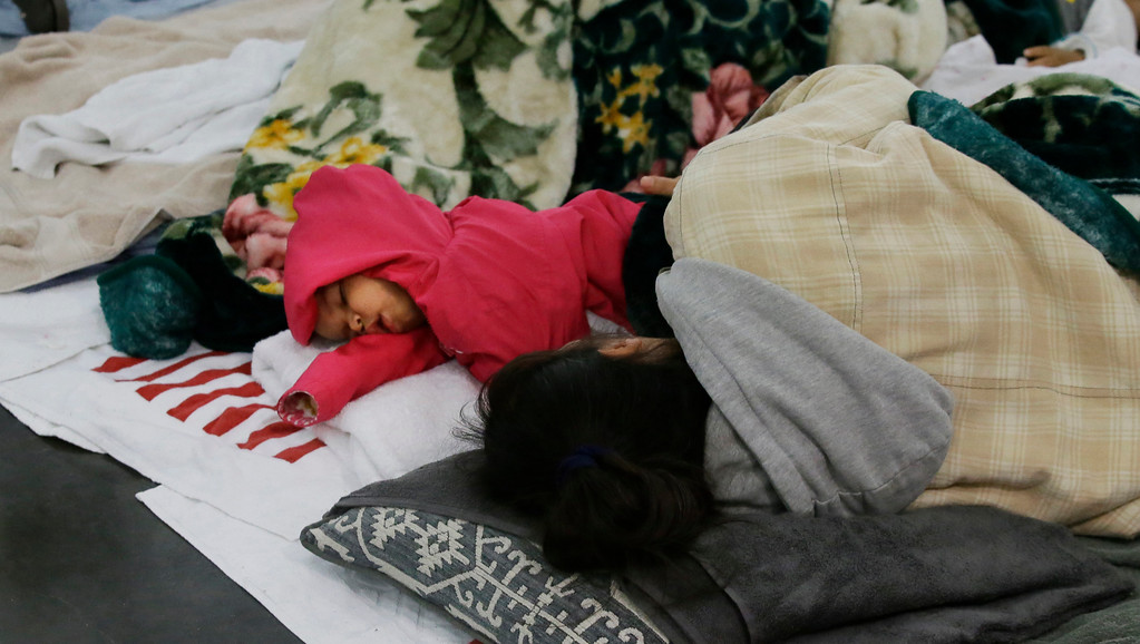 . People sleep at the George R. Brown Convention Center that has been set up as a shelter for evacuees escaping the floodwaters from Tropical Storm Harvey in Houston, Texas, Tuesday, Aug. 29, 2017. (AP Photo/LM Otero)