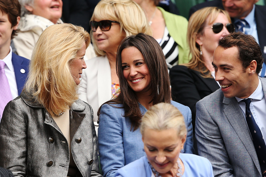 . Pippa Middleton (C), Mariann Byerwalter (L) and James Middleton talk during the gentlemen\'s singles match between Victor Hanescu of Romania and Roger Federer of Switzerland on day one of the Wimbledon Lawn Tennis Championships at the All England Lawn Tennis and Croquet Club on June 24, 2013 in London, England.  (Photo by Clive Brunskill/Getty Images)
