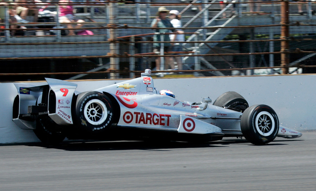 . Driver Scott Dixon, of New Zealand, hits the wall in the fourth turn during the 98th running of the Indianapolis 500 IndyCar auto race at the Indianapolis Motor Speedway, Sunday, May 25, 2014, in Indianapolis. (AP Photo/Kirk Stierwalt)