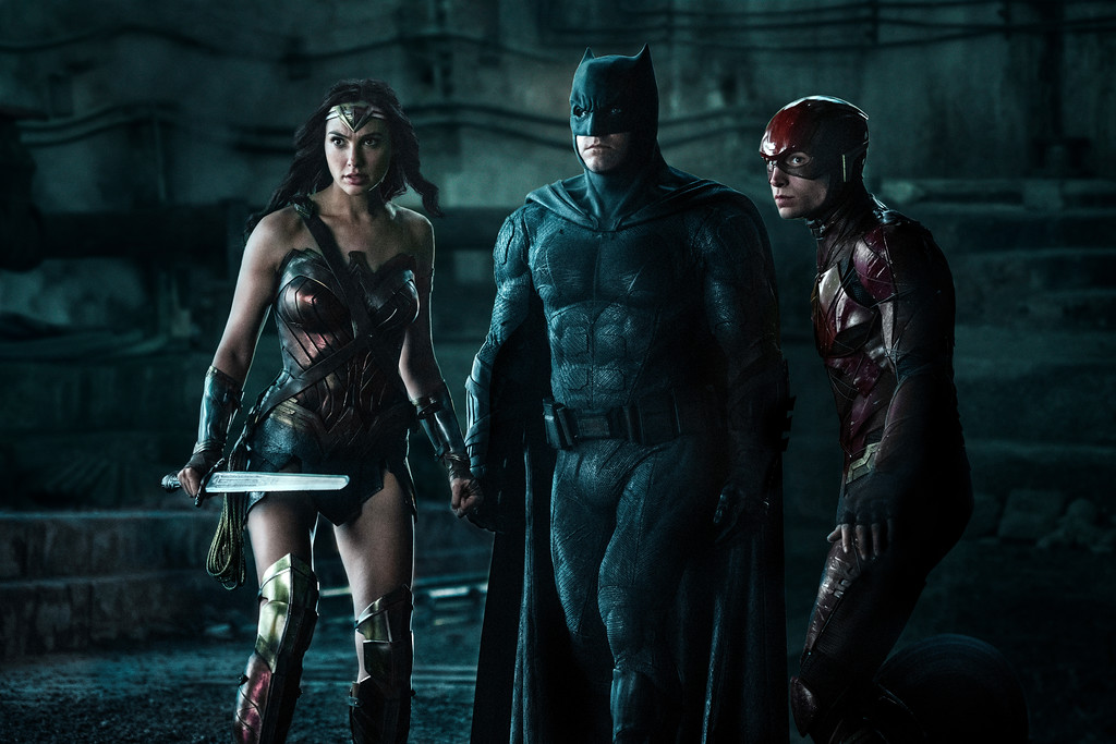 . Gal Gadot, Ben Affleck, center, and Ezra Miller appear in a scene from �Justice League.�  The movie is in theaters Nov. 17. (Warner Bros. Entertainment)