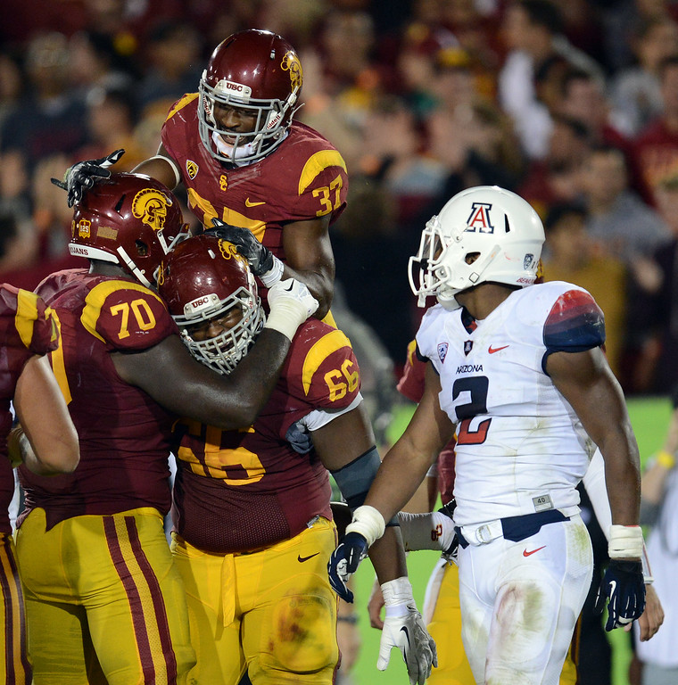 . USC\'s  Javorius Allen #37 celebrates his second half touchdown during their game against Arizona  at the Los Angeles Memorial Coliseum Thursday, October 10, 2013. USC defeated Arizona 38-31. (Photo by Hans Gutknecht/Los Angeles Daily News)