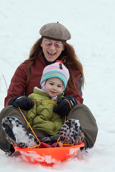 Teri and Freja zoom down the hill at Moraine State Park. There's a place there where families can play in the snow and keep warm by an outdoor wood burning stove. It's a perfect place to have fun on a winter day.