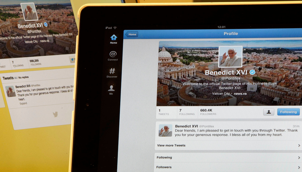 . Pope Benedict XVI\'s twitter account is pictured with his first tweet on an  iPad tablet in this photo illustration taken in Milan December 12, 2012. REUTERS/Stefano Rellandini