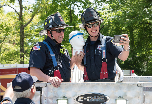 05/21/18 Wesley Bunnell | Staff Bristol Eastern High School students under the leadership of teacher Carolyn Kielma conducted a STEM project with 5th graders from Mountain View School on Monday afternoon involving using protective containers for eggs the 5th graders designed themselves and dropping them from 100ft in the air with the help of Ladder 1 from the Bristol Fire Department. Firefighters Poulton, L, and Wilkinson, R, pose with a project titled egg head.