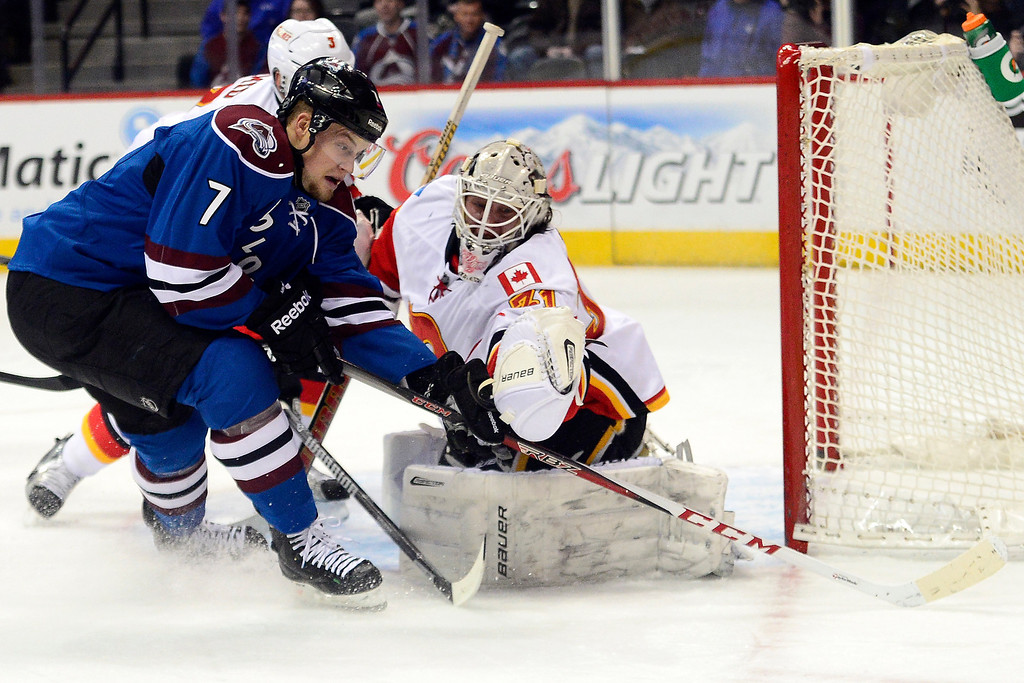 . John Mitchell (7) of the Colorado Avalanche takes a shot on Karri Ramo (31) of the Calgary Flames as Ladislav Smid (3) defends during the first period.  (Photo by AAron Ontiveroz/The Denver Post)