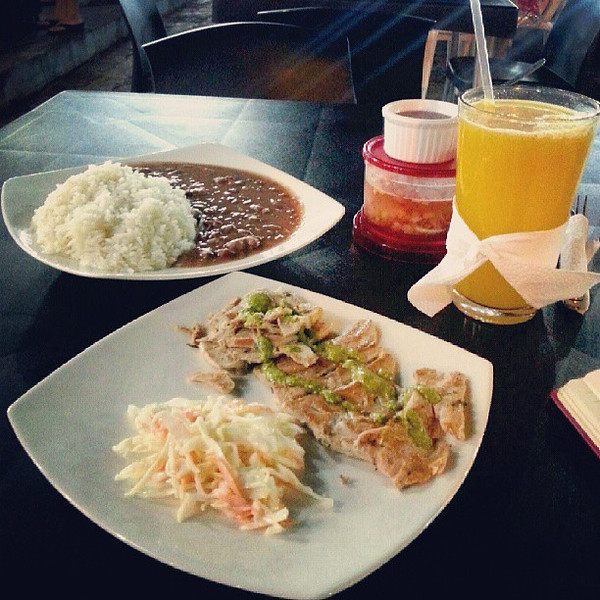 Puerto_Ayora_in_the__Galapagos_is_small_but_there_is_still_a_thriving_street_food_scene._Tonight_I_ordered_grilled_fish_with_salad__rice__beans_and_passion_fruit_juice._Per_usual_the_salad_was_miniscule_but_the_quantity_of_rice_and_beans_warranted_a_.jpg