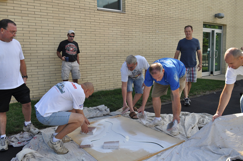 Parents and families of Lutheran West Senior Football players paint Longhorns mentioned in Cleveland Plain Dealer article by Terry Pluto