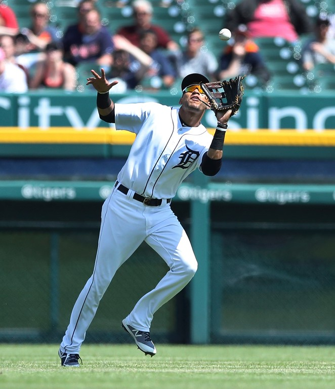 . Detroit Tigers left fielder Victor Reyes catches the fly out hit by Cleveland Indians\' Francisco Lindor during the seventh inning of a baseball game, Wednesday, May 16, 2018, in Detroit. (AP Photo/Carlos Osorio)
