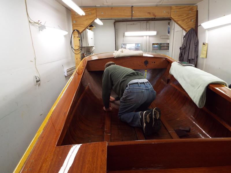 Sanding the inside so we can varnish.