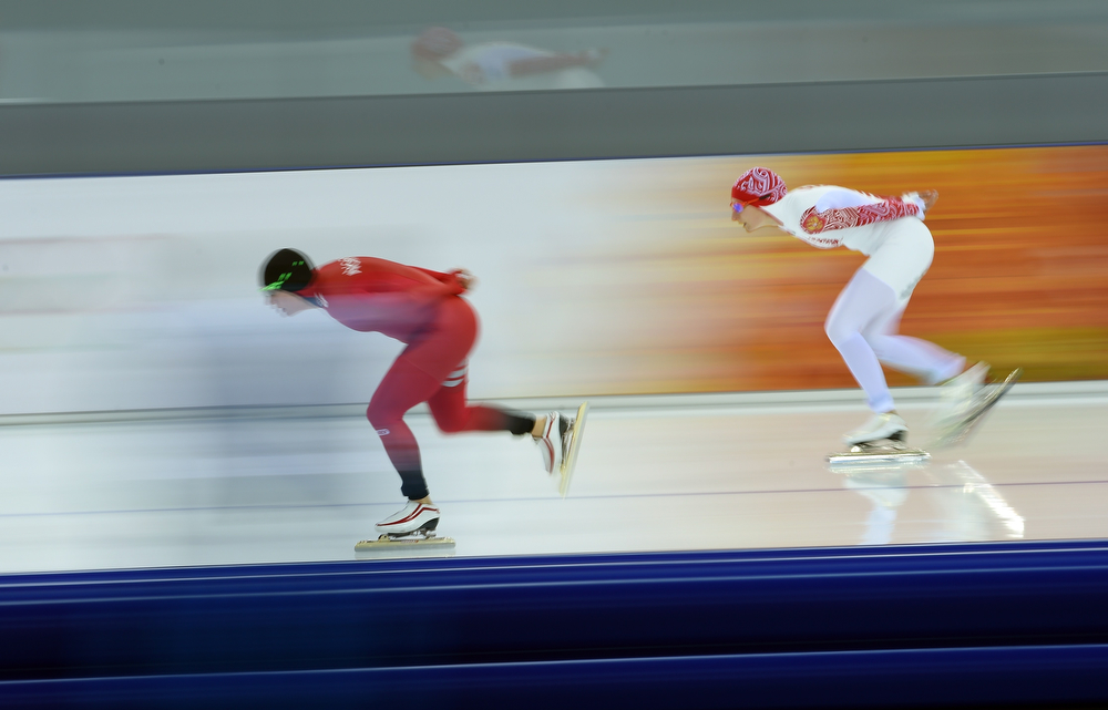 . Russia\'s Anna Chernova (R) and Norway\'s Mari Hemmer compete in the Women\'s Speed Skating 5000 m at the Adler Arena during the Sochi Winter Olympics on February 19, 2014.  (DAMIEN MEYER/AFP/Getty Images)