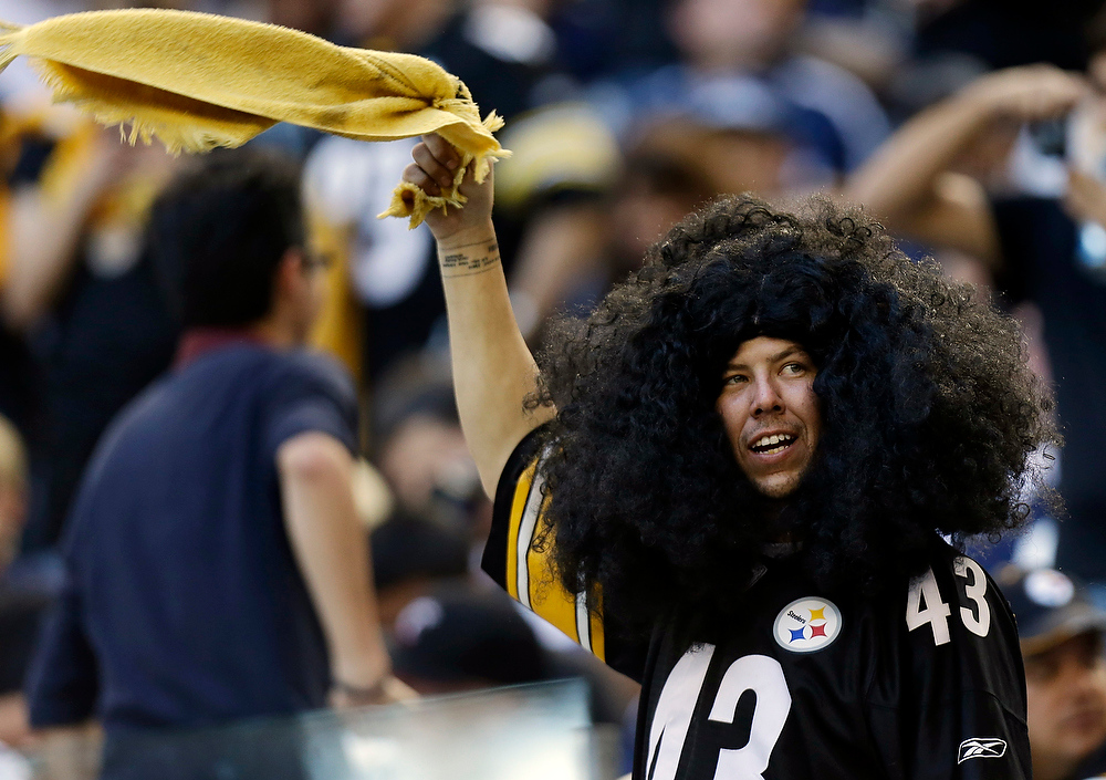 Description of . A Pittsburgh Steelers fan waves his terrible towel before an NFL football game against the Dallas Cowboys Sunday, Dec. 16, 2012 in Arlington, Texas. (AP Photo/LM Otero)