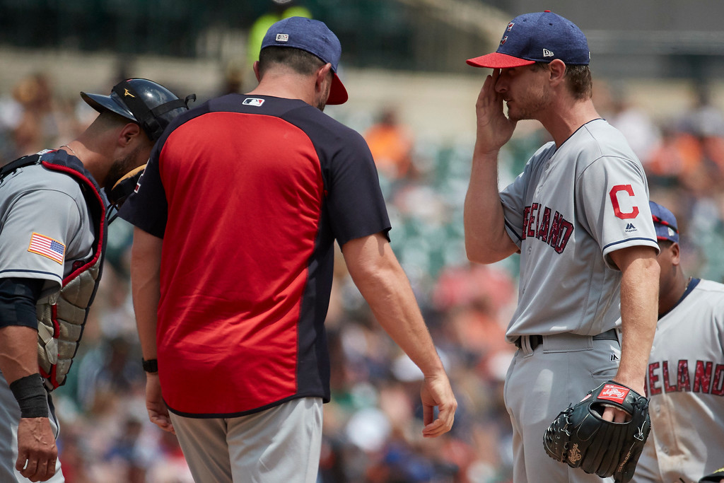 . Cleveland Indians pitching coach Mickey Callaway (32) talks to starting pitcher Josh Tomlin (43) during the fourth inning against the Detroit Tigers in the first baseball game of a doubleheader in Detroit, Saturday, July 1, 2017. (AP Photo/Rick Osentoski)