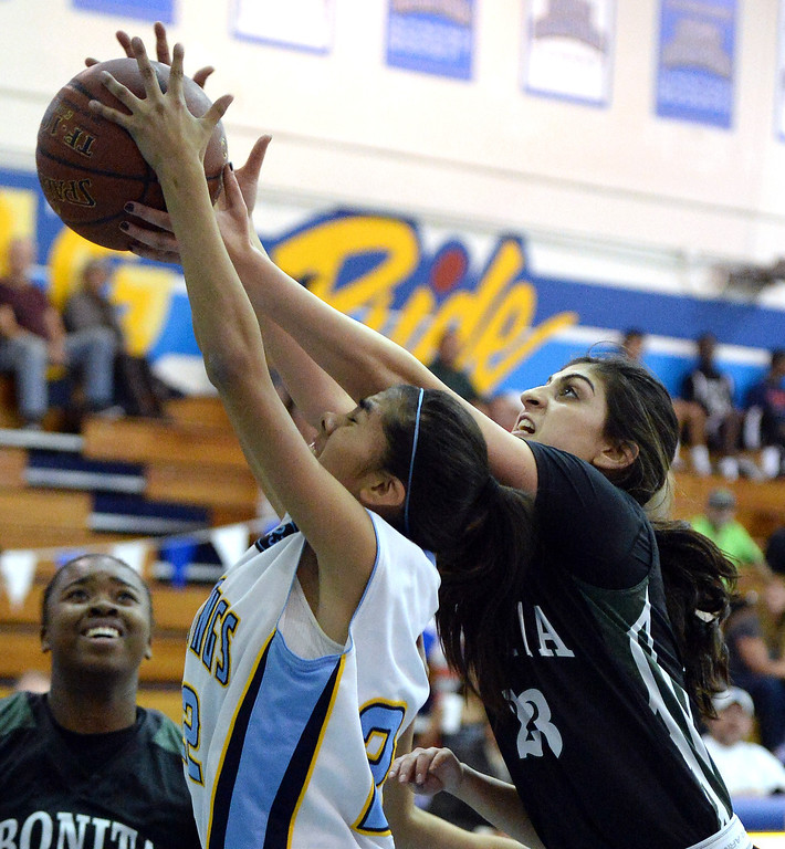 . Walnut\'s Paulina Ochoa (22) fights for the rebound with Bonita\'s Sam Naanouh (23) in the first half of a prep basketball game at Walnut High School in Walnut, Calif., on Wednesday, Jan. 15, 2014. Bonita won 60-50. (Keith Birmingham Pasadena Star-News)