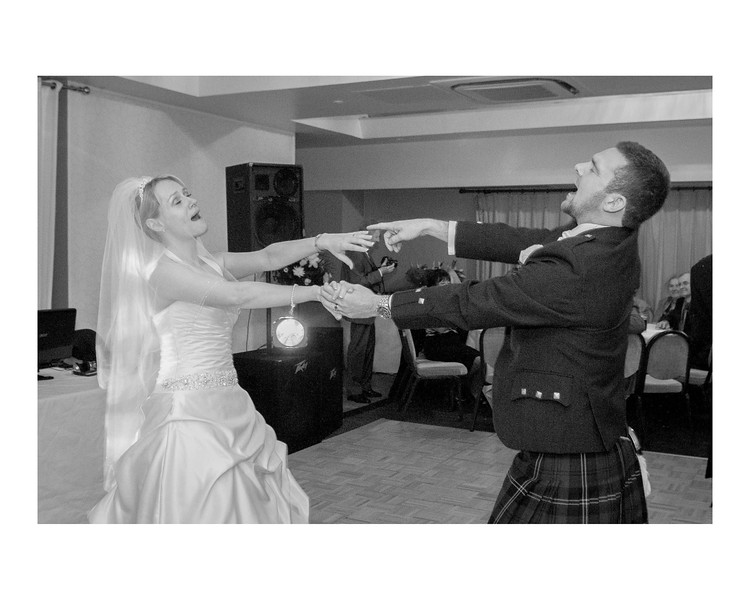 Wedding Photography of Angela & Gordon, Buchannan Arms, Scotland, Phography is of the Bride & Groom wildly dancing