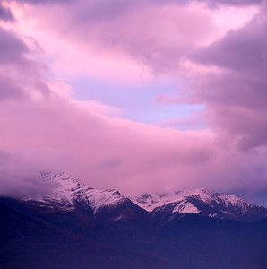 Sunset over snow-capped mountains