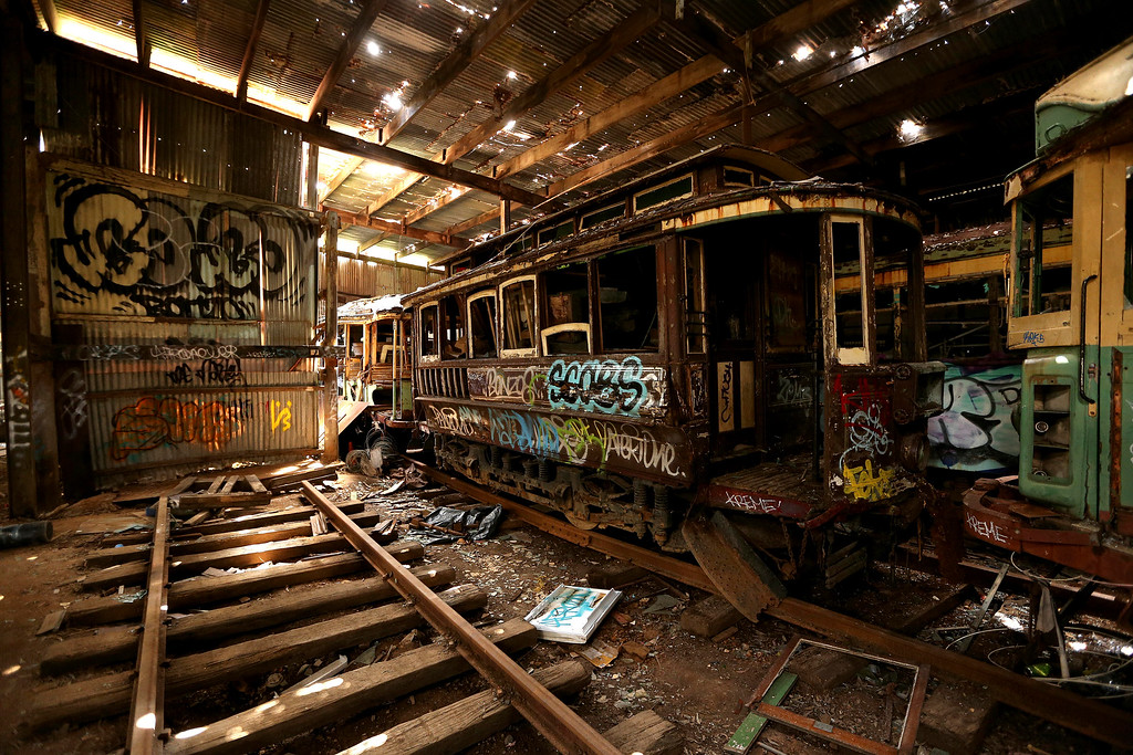 . In this Oct. 22, 2014 photo, old tramcars and trolley buses sit abandoned and wrecked in the Loftus Tram Shed in Sydney. Trams became a key part of life in Sydney after the network was installed in 1879, with 1,600 cars in service during the height of its popularity. The service was eventually shut down in 1961. (AP Photo/Rob Griffith)