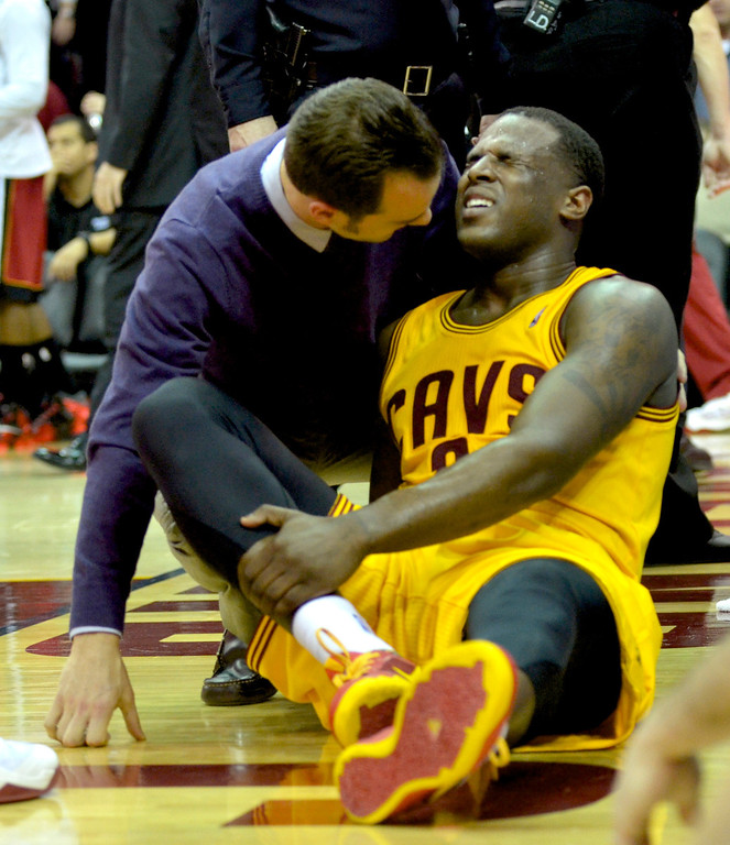 . Jeff Forman/JForman@News-Herald.com Dion Waiters grimaces in pain after taking a hard fall in the fourth quarter of the Cavaliers\' 100-96 loss to the Heat March 18 at Quicken Loans Arena.
