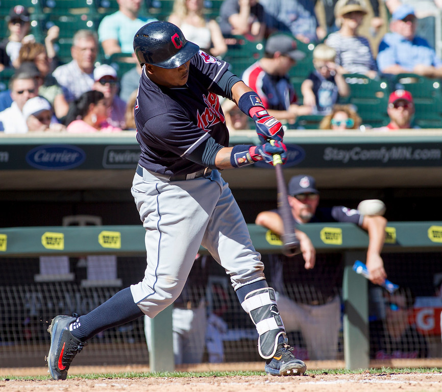 . Cleveland Indians\' Jose Ramirez (11) singles against the Minnesota Twins during the fourth inning of a baseball game, Sunday, Sept. 11, 2016, in Minneapolis. (AP Photo/Paul Battaglia)