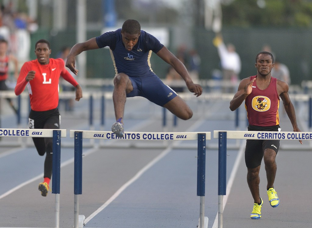 . NORWALK, CALIF. USA -- Los Osos\' Victor Bolden competes in the 300 meter hurdles during the CIF-SS Masters Track and Field Meet in Norwalk, Calif., on Friday, May 24, 2013. Photo by Jeff Gritchen / Los Angeles Newspaper Group