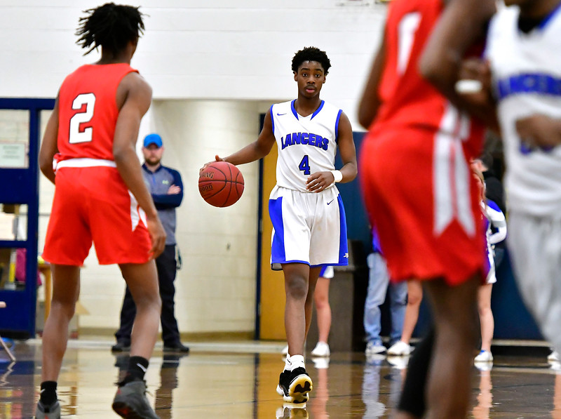 12/29/2018 Mike Orazzi | Staff Bristol Eastern's Jahcyrus Lawrence-Bynum (4) and during Saturday's boys basketball game in Bristol.