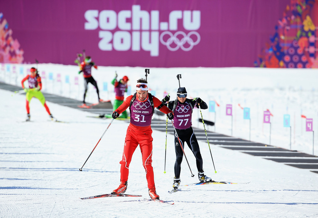 . Benjamin Weger #31 of Switzerland and Michail Kletchorov #77 of Belarus practice during the biathlon training session ahead of the Sochi 2014 Winter Olympics at the Laura Cross-Country Ski and Biathlon Center on February 4, 2014 in Sochi, Russia.  (Photo by Richard Heathcote/Getty Images)