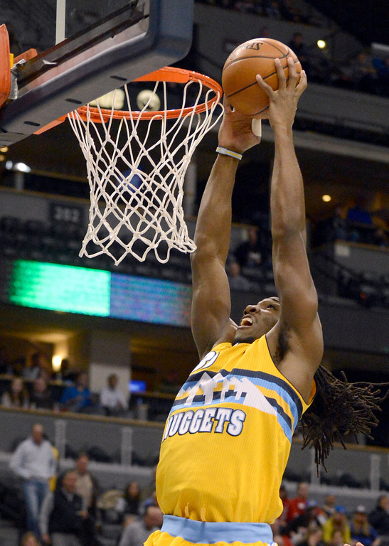 . Denver Nuggets small forward Kenneth Faried (35) goes up for an easy basket in the first quarter against the Portland Trail Blazers  Tuesday, January 15, 2013, at Pepsi Center. John Leyba, The Denver Post