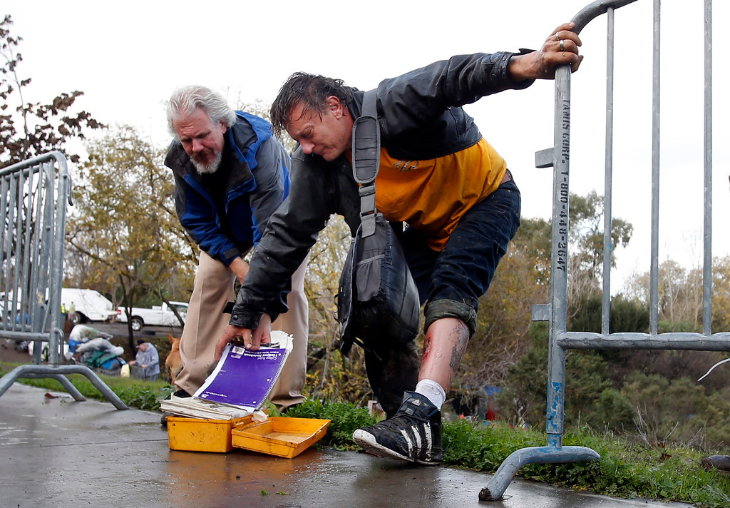 . With a badly infected right leg, Tramp, a resident of The Jungle, leaves the homeless camp with only a few personal papers salvaged from his trailer before being physically evicted Thursday morning, Dec. 4, 2014, in San Jose, Calif. (Karl Mondon/Bay Area News Group)