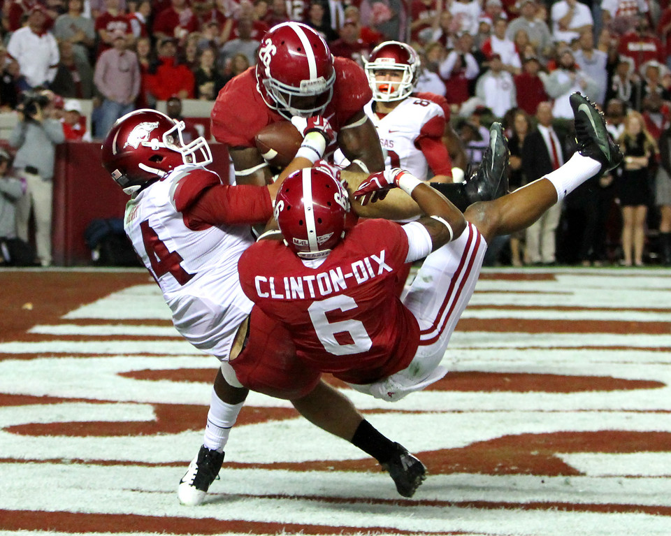 . Alabama defensive back Landon Collins (26) and Alabama defensive back Ha Ha Clinton-Dix (6) break up a pass intended for Arkansas tight end Hunter Henry (84) in the end zone during the first half of an NCAA college football game on Saturday, Oct. 19, 2013, in Tuscaloosa, Ala. (AP Photo/Butch Dill)