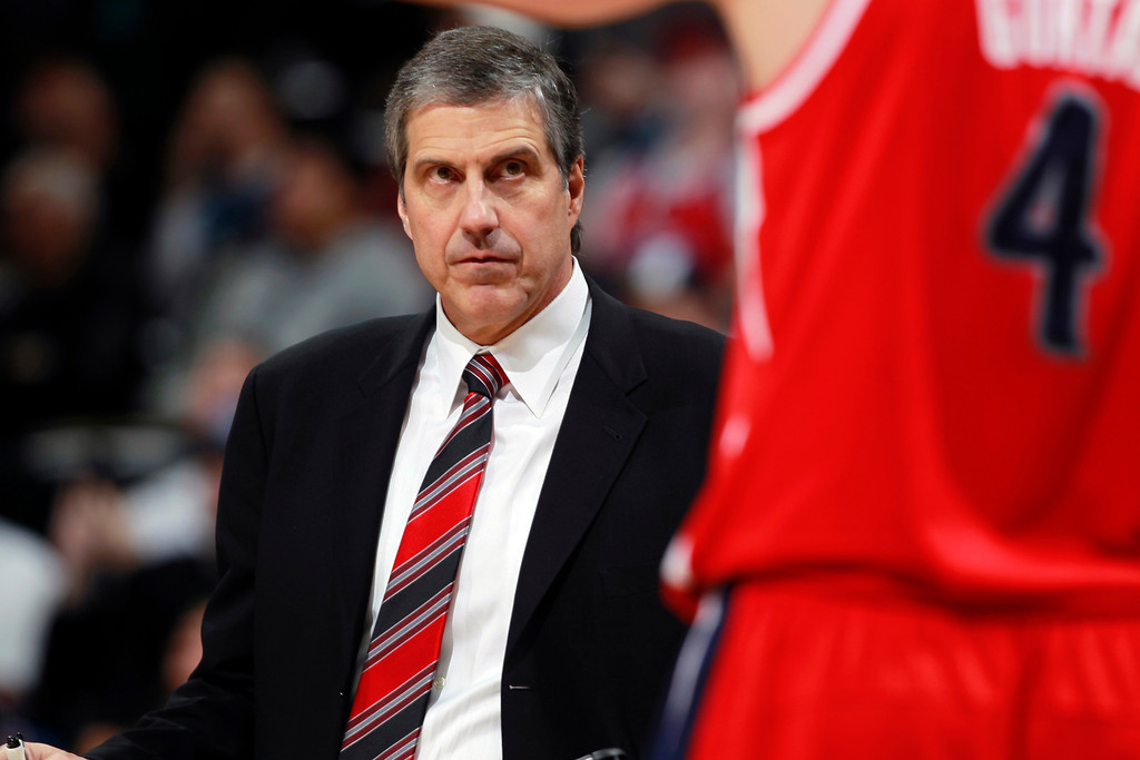 . Washington Wizards head coach Randy Wittman, back, looks at center Marcin Gortat, of Poland, during time out against the Denver Nuggets late in the fourth quarter of an NBA basketball game, Sunday, March 23, 2014, in Denver. The Nuggets won 105-102. (AP Photo/David Zalubowski)