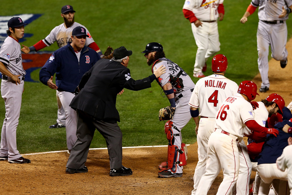 . ST LOUIS, MO - OCTOBER 26:  Manager John Farrell #53 and Jarrod Saltalamacchia #39 of the Boston Red Sox argue an obstruction call with Home Plate Umpire Dana DeMuth #32 in the ninth inning against the St. Louis Cardinals during Game Three of the 2013 World Series at Busch Stadium on October 26, 2013 in St Louis, Missouri.  (Photo by Elsa/Getty Images)