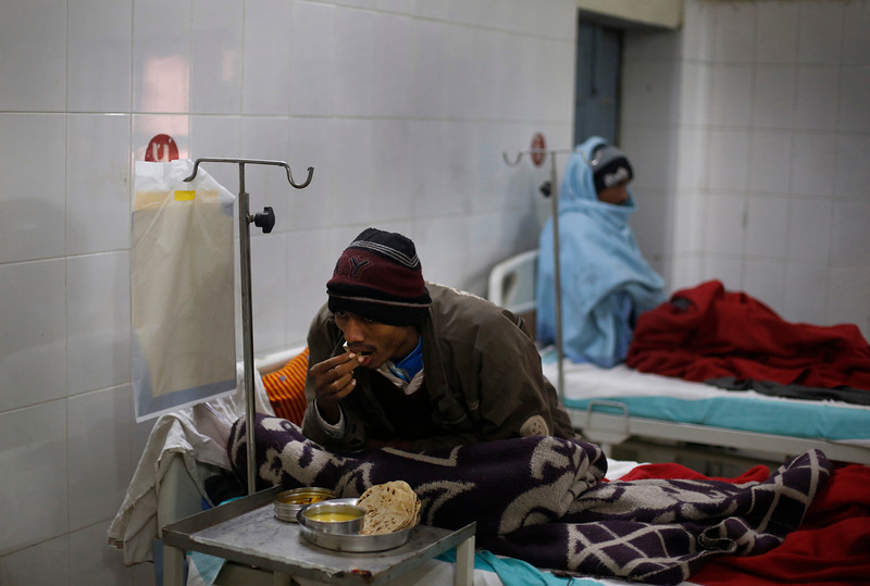 . In this Sunday, Feb. 2, 2014 photo, an unidentified patient suffering from tuberculosis eats his meal on his bed at Lal Bahadur Shastri Government Hospital at Ram Nagar in Varanasi, India. (AP Photo/Rajesh Kumar Singh)