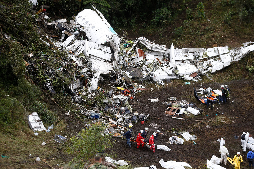 . Rescue workers recover a body from the wreckage site of an airplane crash, in La Union, a mountainous area near Medellin, Colombia, Tuesday, Nov. 29, 2016. The plane was carrying the Brazilian first division soccer club Chapecoense team that was on it\'s way for a Copa Sudamericana final match against Colombia\'s Atletico Nacional. (AP Photo/Fernando Vergara)