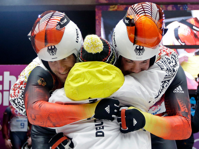 . The doubles team of Tobias Wendl and Tobias Arlt from Germany celebrate in the finish area after their final run to win the gold medal during the men\'s doubles luge at the 2014 Winter Olympics, Wednesday, Feb. 12, 2014, in Krasnaya Polyana, Russia.(AP Photo/Dita Alangkara)