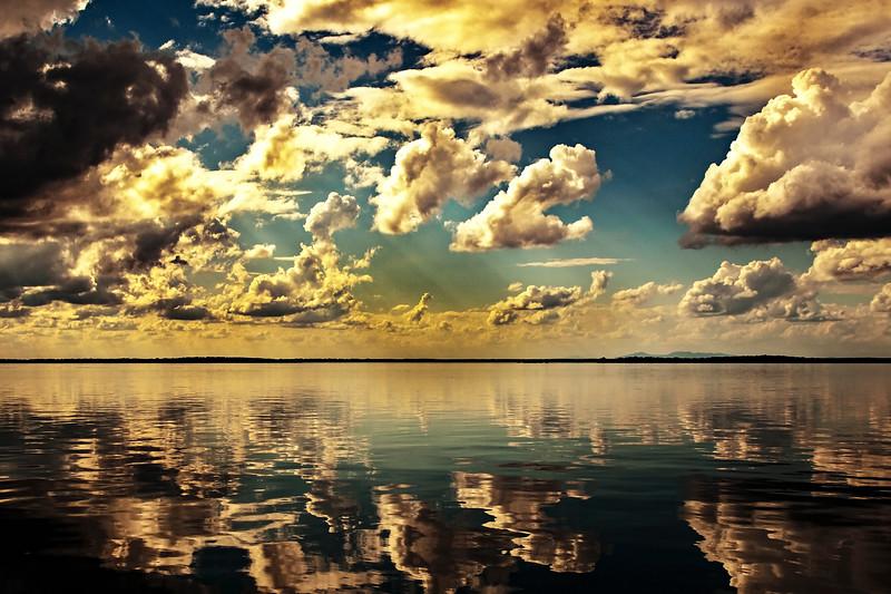 Yellow colored cumulus cloud, sunset seascape.