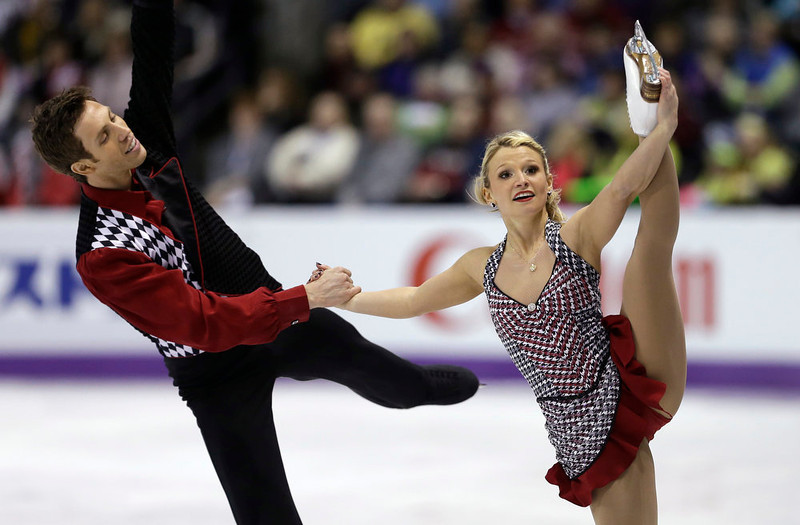 . Kirsten Moore-Towers and Dylan Moscovitch, of Canada, perform during the pairs short program at the World Figure Skating Championships Wednesday, March 13, 2013, in London, Ontario. (AP Photo/Darron Cummings)
