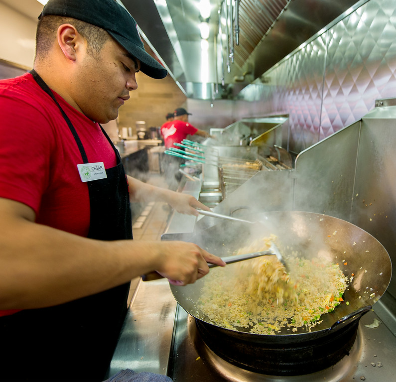 . Chef making fried rice in a wok at Panda Express. This Panda Express, located at 3867 East Foothill Boulevard in Pasadena Thursday, August 21, 2014.  This unique restaurant is the  location of the chain\'s Innovation Kitchen. Here, consumers can try test cuisine and also contribute their own ideas for new dishes.  (Photo by Walt Mancini/Pasadena Star-News)
