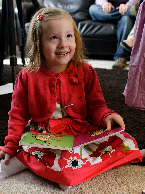 . In this Monday, Feb. 25, 2013, photo, Coy Mathis sits with a book at her home in Fountain, Colo.  (AP Photo/Brennan Linsley)