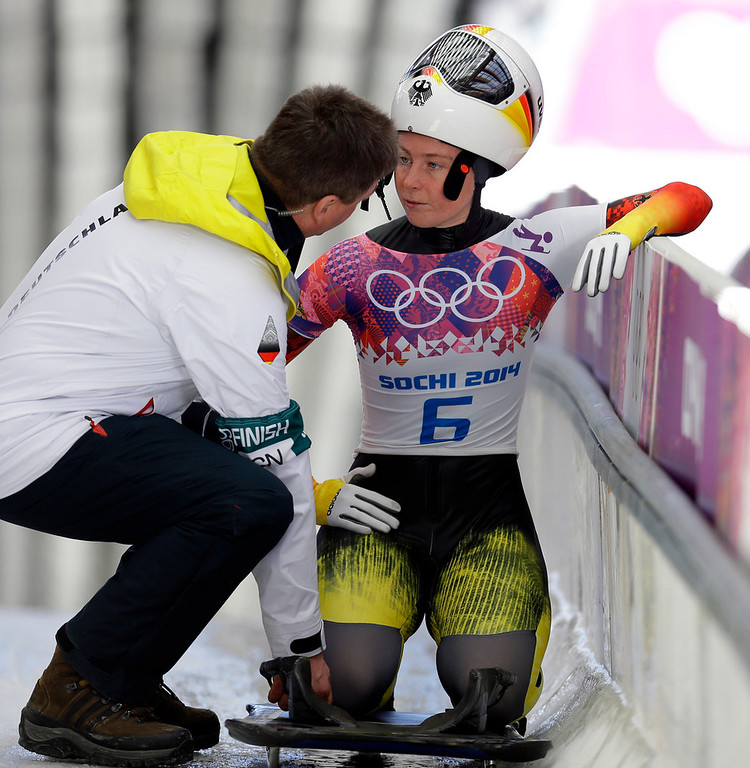 . Marion Thees of Germany speaks to her coach after her second run during the women\'s skeleton competition at the 2014 Winter Olympics, Thursday, Feb. 13, 2014, in Krasnaya Polyana, Russia. (AP Photo/Natacha Pisarenko)