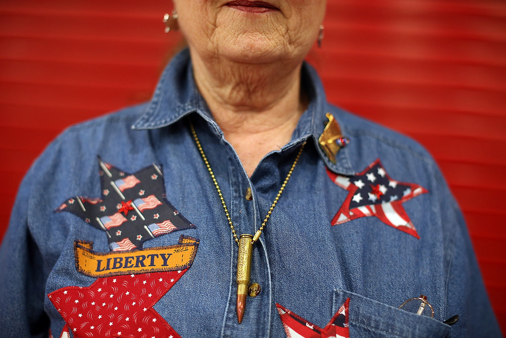 . HOUSTON, TX - MAY 04:  Ann Peay wears a bullet necklace during the 2013 NRA Annual Meeting and Exhibits at the George R. Brown Convention Center on May 4, 2013 in Houston, Texas.  More than 70,000 peope are expected to attend the NRA\'s 3-day annual meeting that features nearly 550 exhibitors, gun trade show and a political rally. The Show runs from May 3-5.  (Photo by Justin Sullivan/Getty Images)