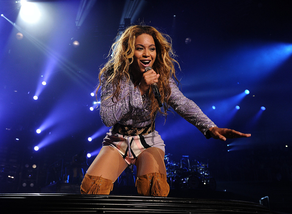 ". Singer Beyonce performs on her ""Mrs. Carter Show World Tour 2013\"", on Wednesday, April 17, 2013 at the Arena Zagreb in Zagreb, Croatia. Beyonce is wearing a lilac jacket and boots by Pucci. (Photo by Frank Micelotta/Invision for Parkwood Entertainment/AP Images."